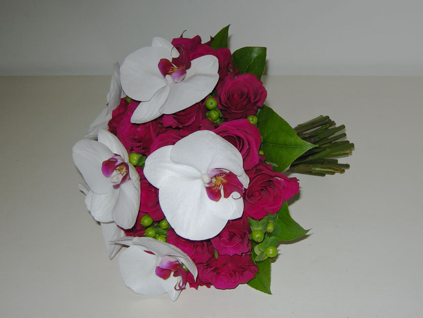 green hypericum berry and a phalaenopsis orchid called Red Lips which