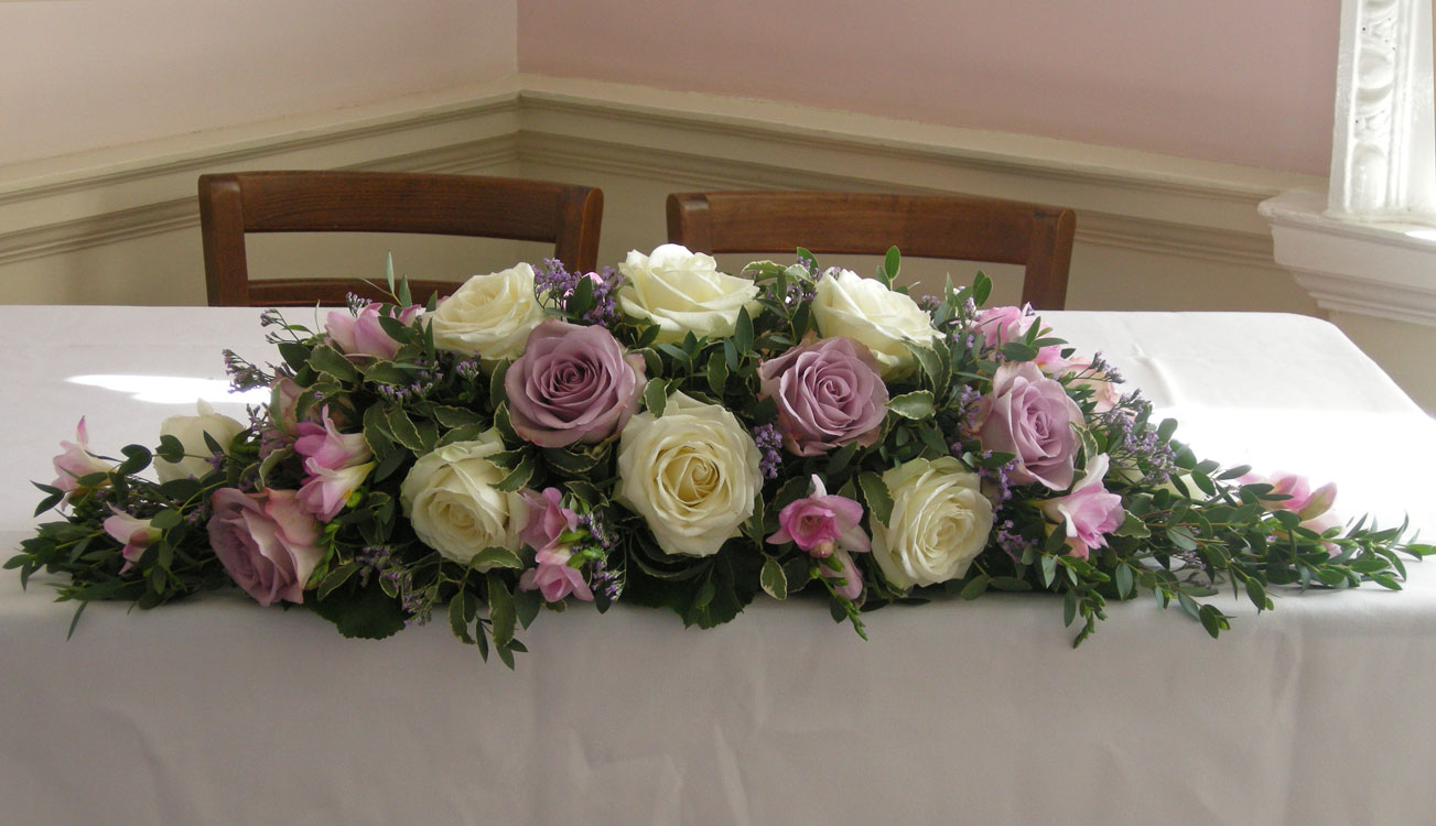 Top table flower arrangements for weddings images for Table arrangements