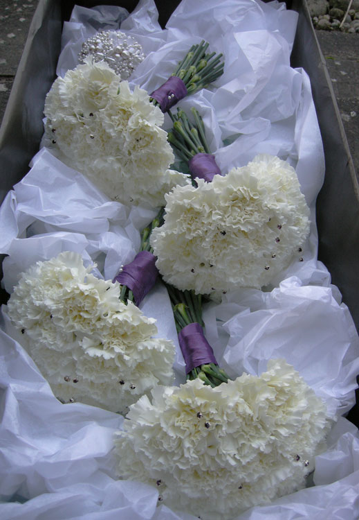 in themed white winter weddings Ivory and purple bridesmaid 39s bouquet