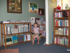 Audrey Dressing Up Amidst the Books