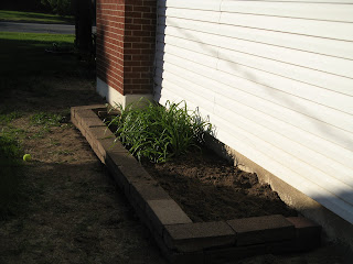 New flowerbed on west side of house