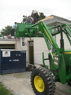 I also borrowed a tractor to lift the shingles to the roof