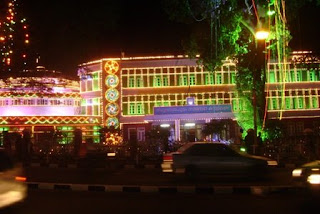 a government office illuminated with color lights for onam celebrations