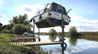 funny boat stuck high after flood