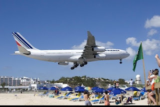 funny fridays photos low flying air france plane on beach