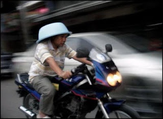 funny bowl wearing man on motorbike maybe as helmet picture