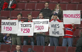 funny sports fans signs mastercard priceless wives at home photo