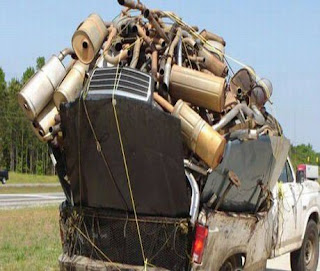funny crazy photo of overloaded pick up truck full of mufflers and car parts