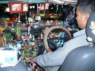 funny cars photos taxi driver filled with trinkets and rubbish