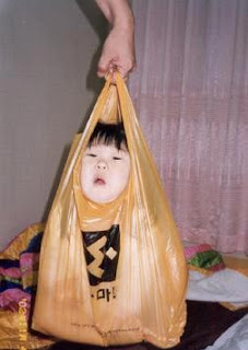 really weird photo of one bag policy in china young boy in plastic bag