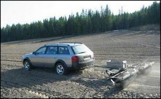 funny plough photo of car doing the job of a tractor weird but it works