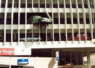 funny car photo balancing on edge of carpark building accident