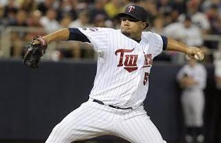 Minnesota Twins Pitcher hurling the ball into home plate