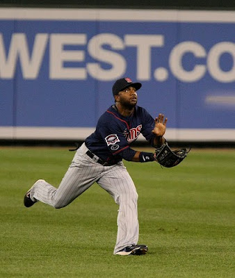 Center Fielder Denard Span tracks down a fly ball for the Minnesota Twins