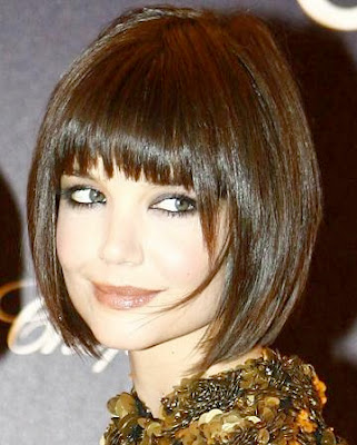 Trendy black medium blunt bob hairstyle with bangs