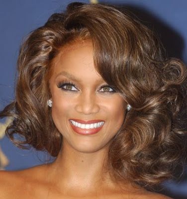 Tyra Banks with her 1950s pin cropped curls hairstyle.