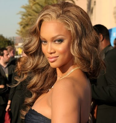 Tyra Banks's goes for the gold, ultra wavy with wind blown hairstyle look on