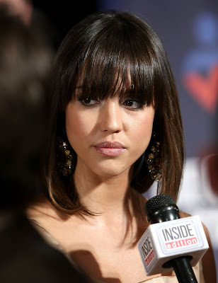 Jessica Alba is wearing her hair in a sexy sleek shoulder length hairstyle