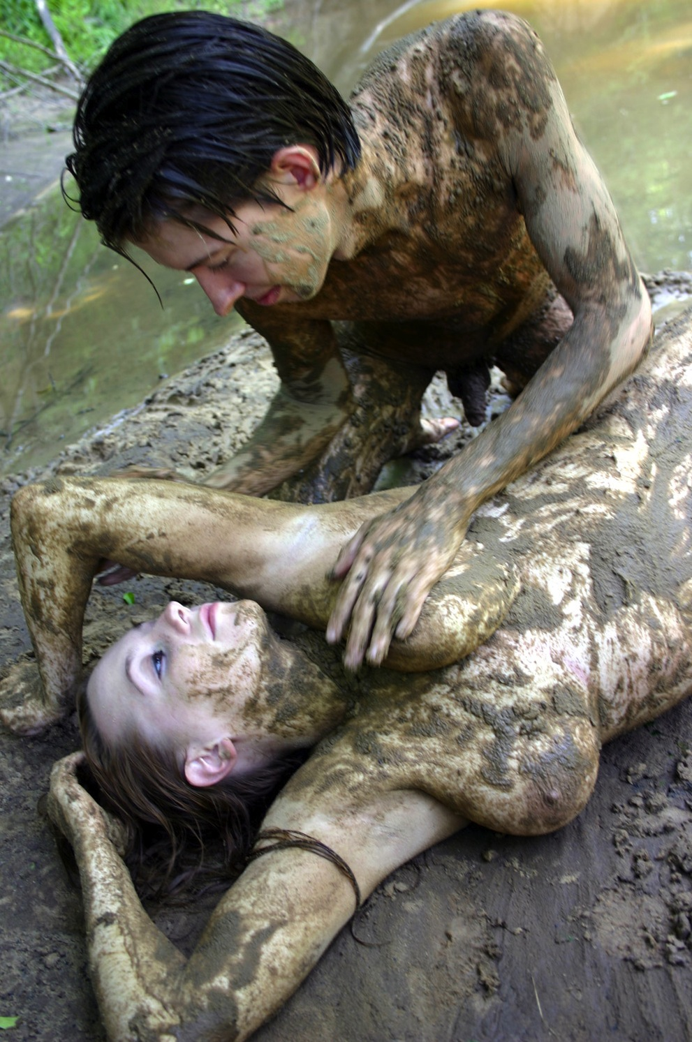 nude couple in mud