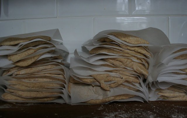 Stacks of pitta bread, waiting to go in the oven