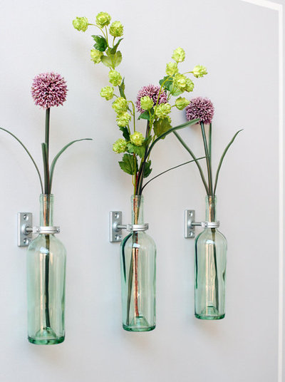 Diy wall mounted wine bottle vases root simple for Wine bottle vase ideas