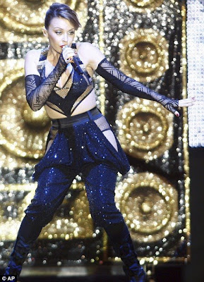 hot Kylie Minogue performs in a futuristic ensemble during a concert at the 8th Mawazine festival