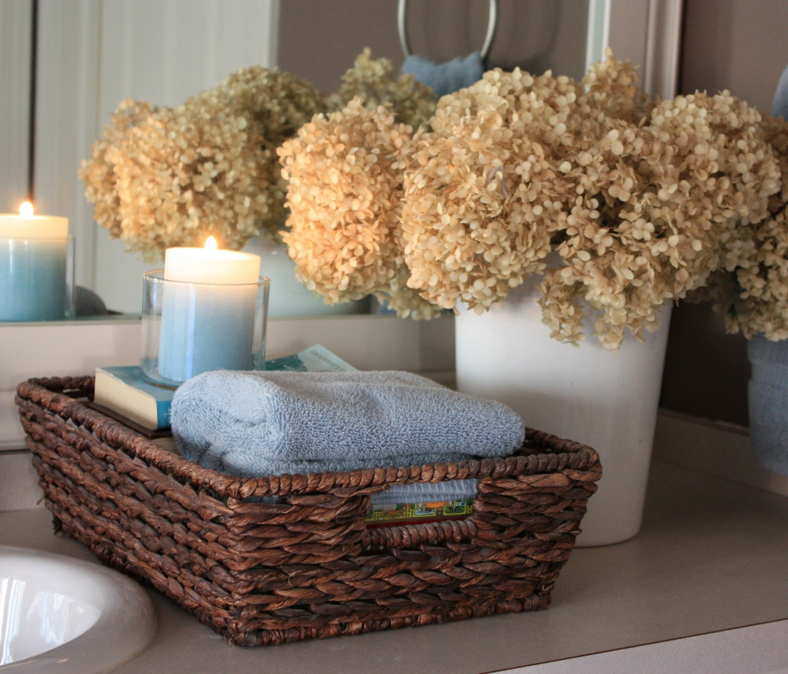 The yellow cape cod bathroom upgrades - How to decorate a bathroom counter ...