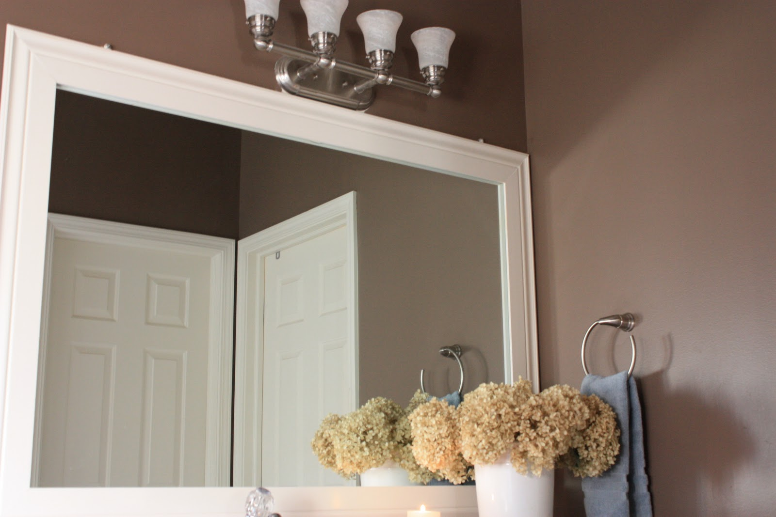 The yellow cape cod bathroom upgrades - Frame bathroom mirror with moulding ...