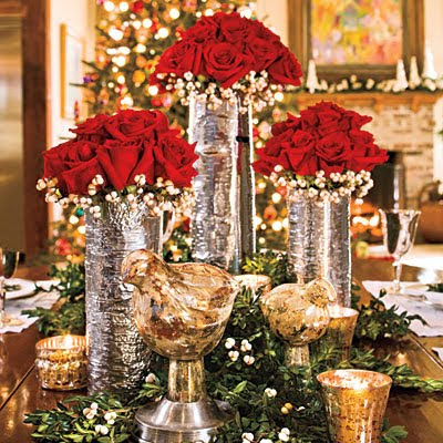 Silver christmas centerpiece with red roses