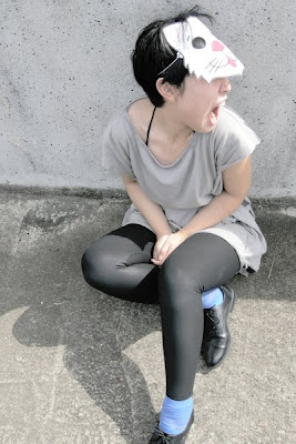 girl with paper cat mask on, leggings, socks and oxfords, brogues, lace-up flats,