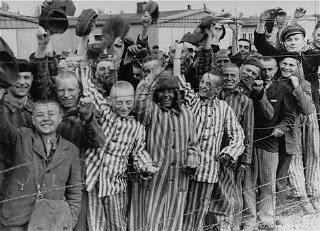 Liberated Dachau camp prisoners cheer U.S. troops