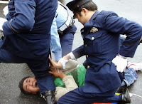 A Tibetan protester being arrested by Japanese police
