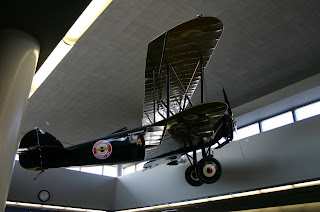 An antique airplane hanging in the Minneapolis airport.