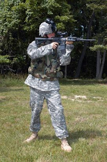 A soldier discharging his weapon.