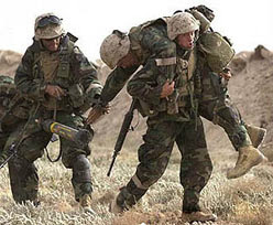Marines rescuing a wounded brother.