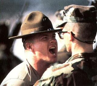 A Marine DI gets in a recruit's face.