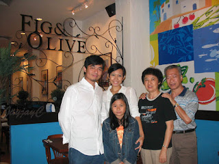Posing with my beloved spouse John, younger son Darren and his family