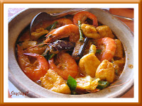 A clay pot of curry prawn with others