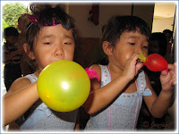 Renice and Renee, had fun blowing their balloons