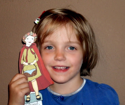 girl with paper doll