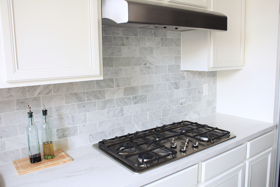 The Kitchen Backsplash Is Done Nicely Via Made By December 21 2010 64 Comments Carrara Marble Tiles