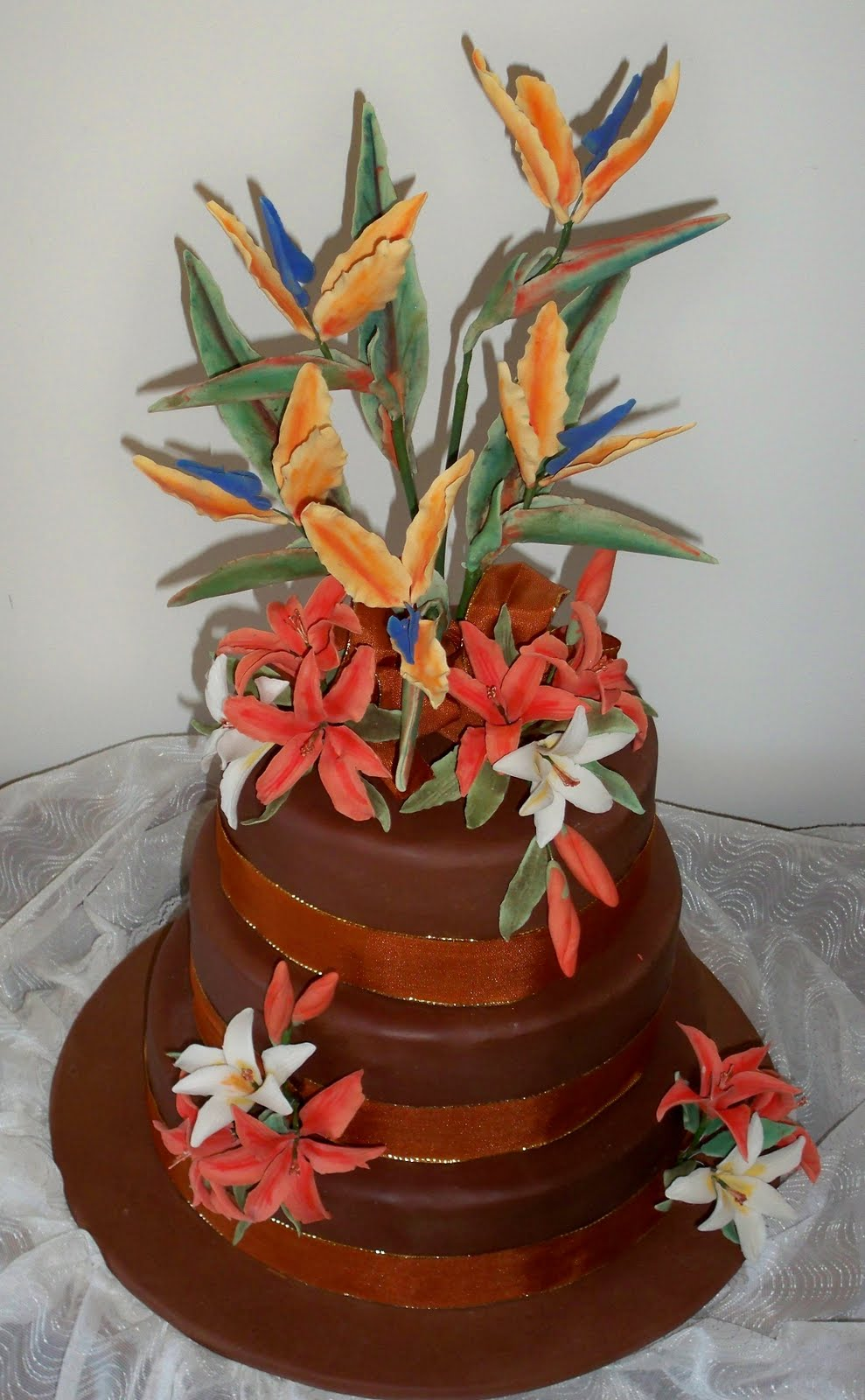 Tropical bird of paradies and lilies sugar flowers elisabeths when i got an inquiry for a tropical sugar flower arrangement on a chocolate wedding cake i got very excited i have never done bird of paradise sugar izmirmasajfo