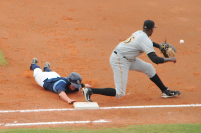 Mark Thomas dives back to first to avoid being doubled off at first in Sunday's game against Bradenton.  Photo by Jim Donten.