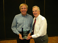 Jim Holland receiving award during the Fall Meetings.  Photo courtesy of Princeton Rays.