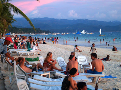 In Panay is the famous Boracay Island. Boracay Island is located off the  northwest corner of Panay in Region VI of the Philippines. The island is approximately  seven kilometers long, dog-bone shaped with the narrowest spot being less than one  kilometer wide, and has a total land area of 10.32 square kilometers. The name Boracay  has various rumoured origins. One of which was that it is drived from the local word of  borac or sagay which means cotton in reference to the white cotton like colour and  texture of Boracays sand.