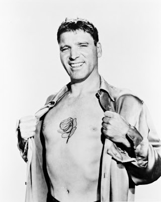 Burt Lancaster is proud over his (probably painted-on) tattoo.