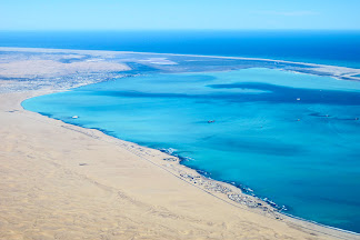 Atlantic Ocean and sand dunes from skydiving plane, Swakopmund, Namibia © Matt Prater