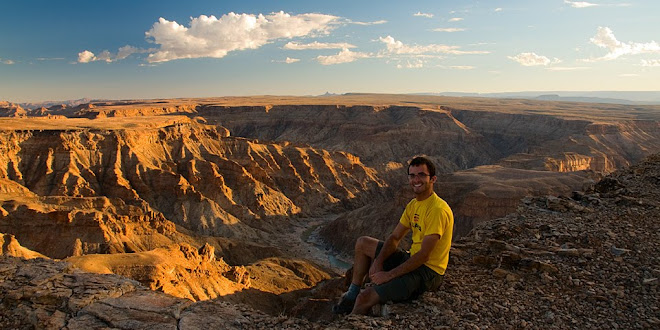 Sitting on the edge of Fish River Canyon, Namibia