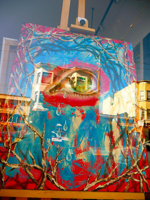 photo of streetart in San Francisco on 16th Street featuring an eye and thorns