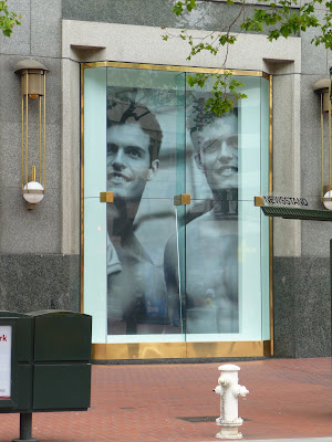 photo of an Abercrombie and Fitch window in downtown San Francisco with two hot studs
